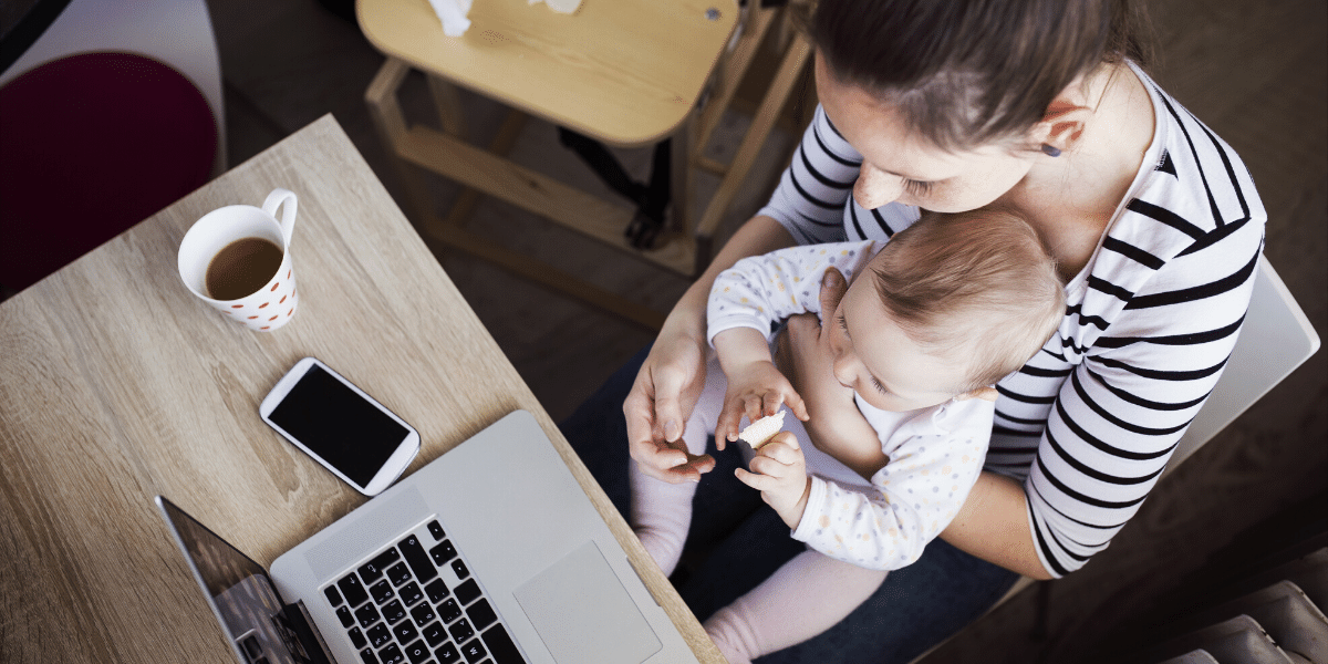 Woman working from home with baby on her lap